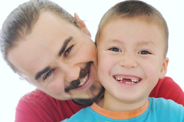 Happy father and boy smiling