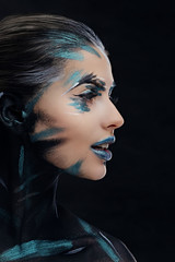 A woman with artistic make up.