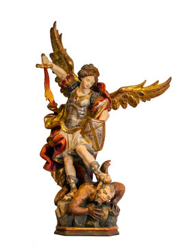 18th century Saint Michael Archangel statue created in the Baroque art style isolated on a white background