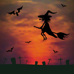 witch flying on a broom against the sunset over the cemetery. ha