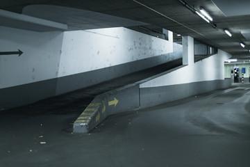 Lane going up to first floor in parking garage.