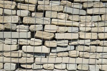 Stone bricks for wall construction