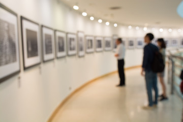 People Watching Photo in Art Gallery