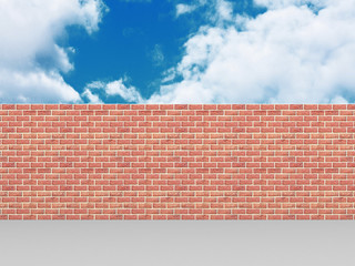 High brick wall on blue cloudy sky background