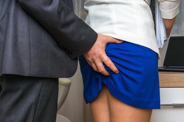 Obraz Man touching woman's butt - sexual harassment in office - fototapety do salonu