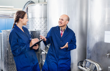 Woman and standing man in fermentation section