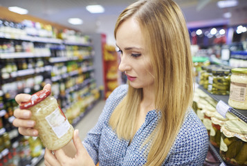 Undecided woman trying to find the product