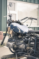 Old Russian Dnepr motorcycle with no front weel side view