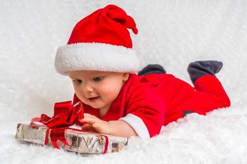 Happy little baby celebrates Christmas