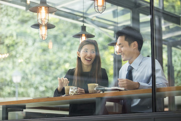 Asian business people meeting in a cafe.