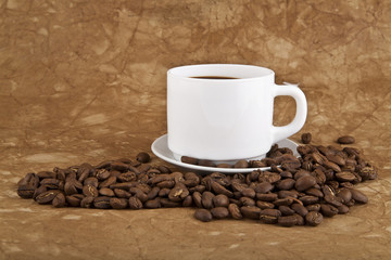 cup with hot coffee and grains