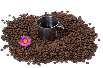 grains of black coffee, inside cup of coffee
