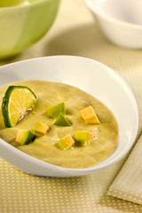 Avocado soup in a white bowl