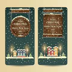 Christmas banners with inscription. Happy New Year. Snow-covered houses in the evening. Flat