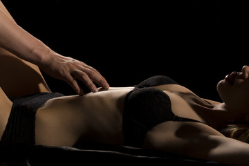 Man touching woman during foreplay