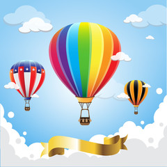 Hot air balloon in the sky with gold banner ribbon cloud background