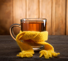 Printed roller blinds Tea Healing glass of tea in a scarf and a lemon on a wooden backgrou