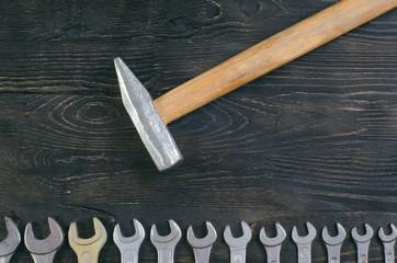hammer on wooden background spanner