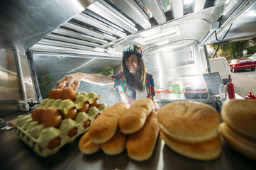 Female in colorful van cooking