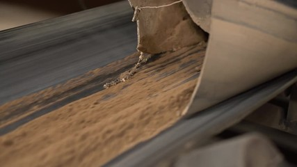 Wall Mural - Brick production. View of sand moves on conveyor