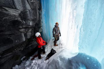 Two men preparing for ice climbing