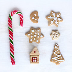 holiday Christmas Puzzle/ flat layout with ginger cookies figure, sweet candy, and house