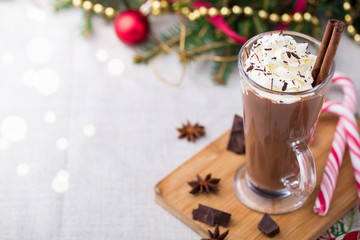 Hot chocolate with whipped cream. Christmas table.