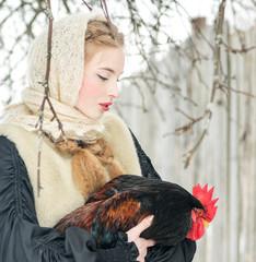 Beautiful Russian woman in a traditional dress. Russian village.