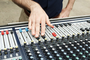 Soundman's palm and microphone on sound mixer