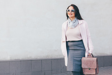 Plus size model in pink coat