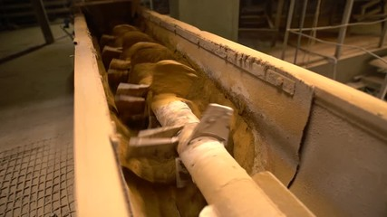 Wall Mural - Brick industry. View of screw conveyor, close-up