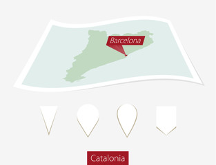 Curved paper map of Catalonia with capital Barcelona.