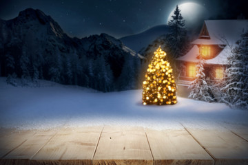 christmaas time and wooden desk of free space