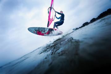 Windsurfer stunting on waves