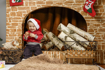 Children playing near the Christmas tree with gifts