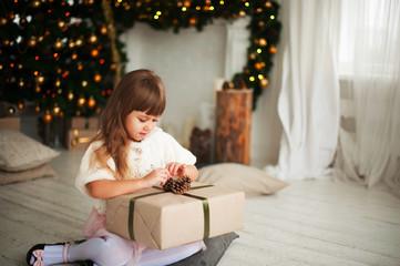 Smiling girl near a Christmas tree