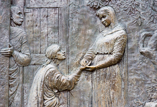 Medjugorje, Bosnia and Herzegovina, 2016/11/12. Bronze relief representing the visitation of Saint Elizabeth by Virgin Mary.