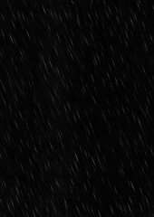Falling rain drops on a black background