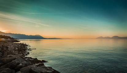 Peaceful landscape with sea and hills before sunrise