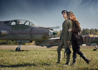 The guy and the girl, pilots preparing to fly on a plane.