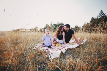 young family with a child have fun outdoors