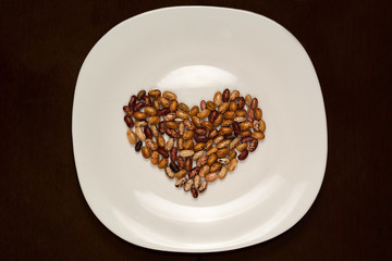 plate with beans in the shape of heart
