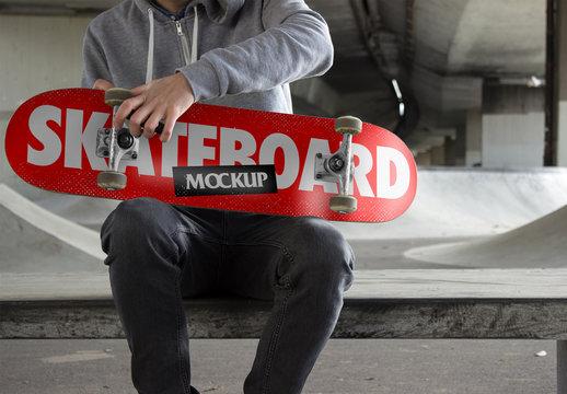 Sitting Skater with Board Mockup