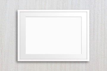 Blank photo frame mockup on textured wallpaper