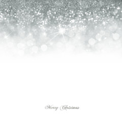 Christmas card with Bright silver bokeh background