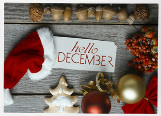 hello december, welcome winter greeting card frame of Winter and Christmas decor Poster with sunlight filter and toned grunge image