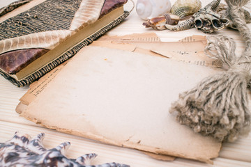 Vintage style rustical mockup with sheet of old blank paper on a wooden texture