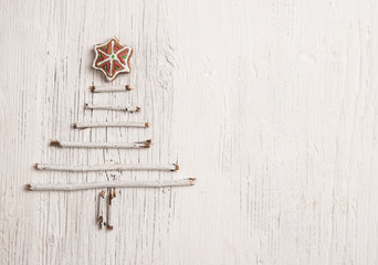 Handmade New Year decoration over shabby wooden background