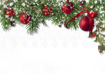 Christmas card with fir branches, balls and holly on white background