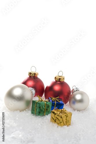 Quot vertical christmas ornaments on white snow stock photo